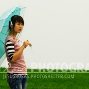 May Fourth Square, Chinese girl with an umbrella in Qingdao, Shandong, China.