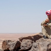 Picture of a Bedouin sitting on Qasr Usaykhim