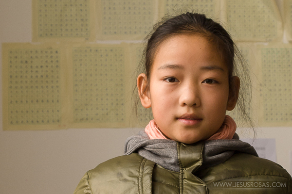 Picture of a Chinese girl with a green jacket and pink scarf
