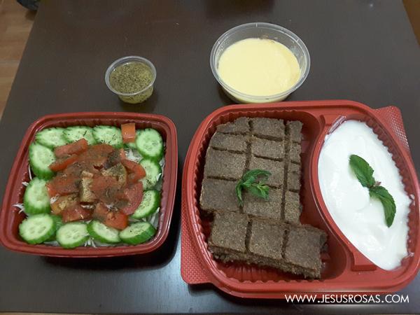 Kebbeh bil sayniye, malfouf salad, laban, custerd in Al Wakra, Qatar.