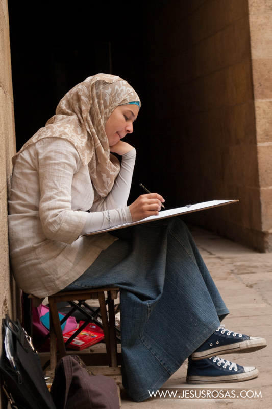 Another young college student drawing at the Gayer-Anderson museum. She is wearing the hijab, a women's veil that covers the head. The hijab is commonly used by Muslim women. Cairo, Egypt. 2009.Another young college student drawing at the Gayer-Anderson museum. She is wearing the hijab, a women's veil that covers the head. The hijab is commonly used by Muslim women. Cairo, Egypt. 2009.