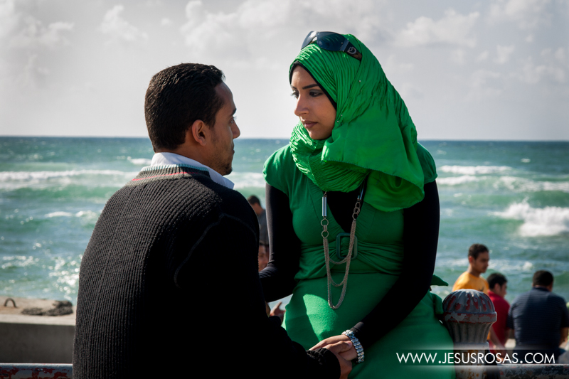 One of my favorite pictures. This couple was so immersed in each other's gaze that they didn't notice that I was there and even took a picture of them. The woman is wearing the hijab to cover her hair. In the background the Mediterranean Sea. Alexandria, Egypt. 2009.