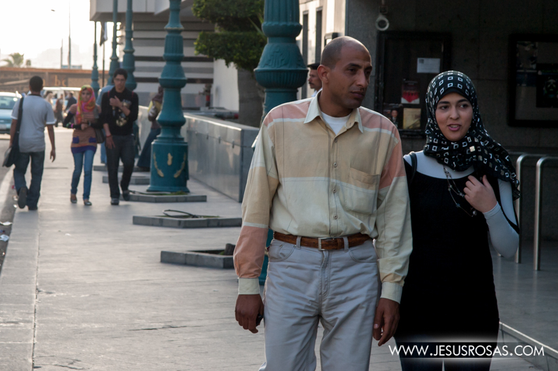 Another couple walking in the streets of Alexandria. The woman also wearing her hijab to cover her hair. Alexandria, Egypt. 2009.