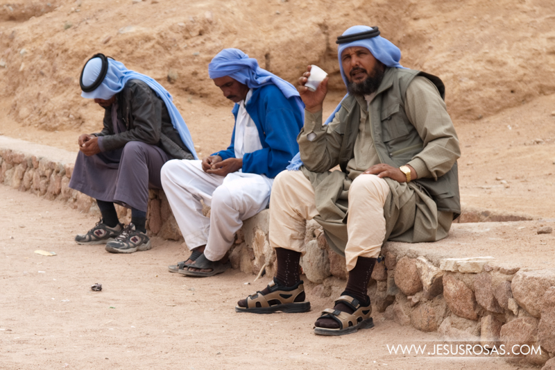 A group of Bedouins near the Saint Catherine Monastery at Mount Sinai. The Bedouins are Arabs traditionally nomadic. Gradually some of them begin to adopt Western customs such as wearing sport shoes and wrist watches. Sinai Peninsula, Egypt. 2009.