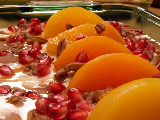 Pastel helado with peaches, pomegranate, and pecans Jesús Rosas' style