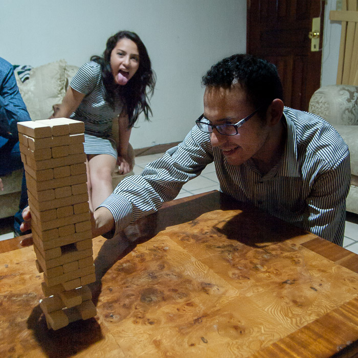 Playing Jenga.