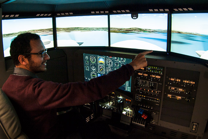 Picture of Jesús Rosas in a flight simulator.