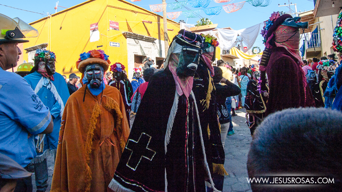 "Masked men with their outfits representing the ""morenos"" during the Magi or three kings procession in Cajititlan, Tlajomulco, Jalisco, Mexico."