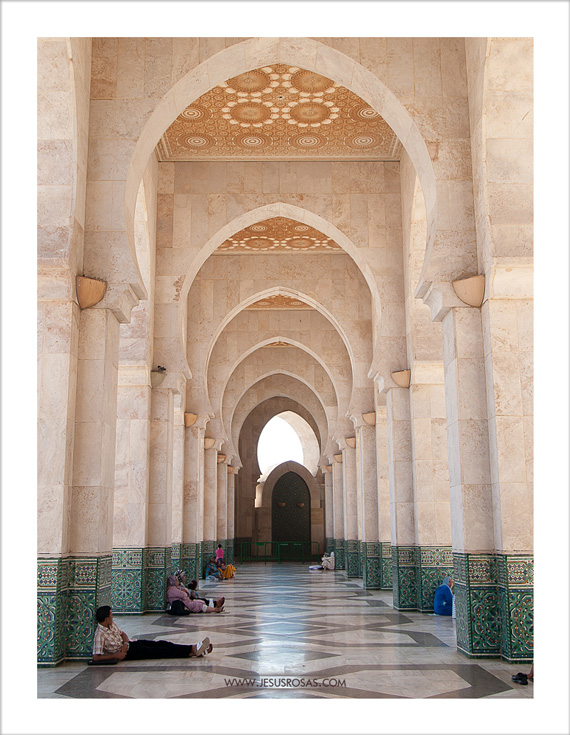 And of course, more arches and pillars with mosaics at the bottom of each column. Some enjoy a moment in the shade to rest.