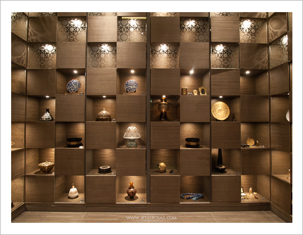 Wall with small squared spaces to put items such as plates, lamps and others