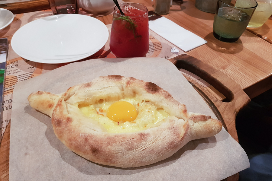 Here's a delicious Khachapuri I got in Kiev, Ukraine. This traditional dish from Georgia is bread filled with cheese and an egg on top. It's served hot and it's something I like very much. However, there are different versions of this dish. I have found one that has a non-melting cheese that it's too salty for me.