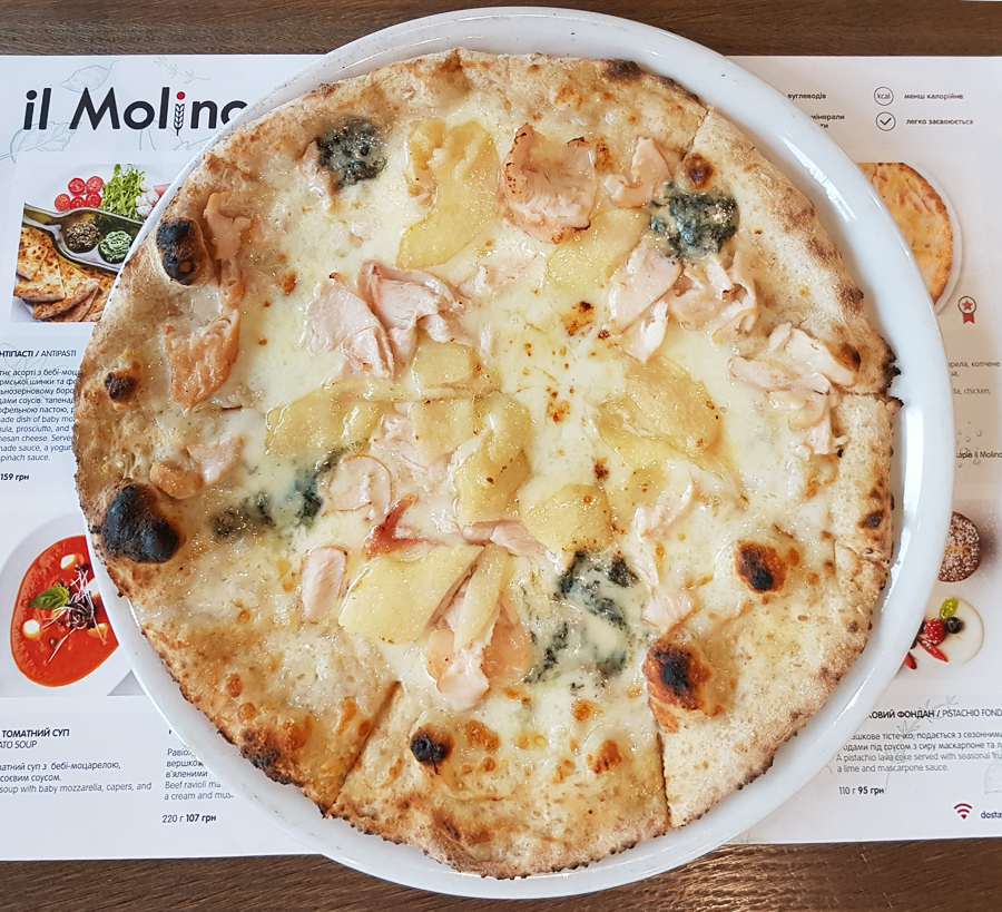 Here it is the best pizza I ate in 2018 and probably in the last few years since I went to Veracruz, Mexico. I'm a big fan of sweet and salty meals. Specifically fruits with salads, meats, breads and the like. This is the Tenerezza pizza from Il Molino in Kiev, Ukraine. The main ingredients are mozzarella, chicken, honey marinated pear, Gorgonzola, and Parmesan cheese. Bread was thin but slightly crunchy and soft at the same time. It was perfect. I couln't ask for any better way to have the bread. The ingredients were great. Each slice had a mix of flavors, sweet thanks to the pear then strong with the gorgonzola cheese flavoring the lean chicken then sweet again on the next slice. So good! https://ilmolino.ua/en/