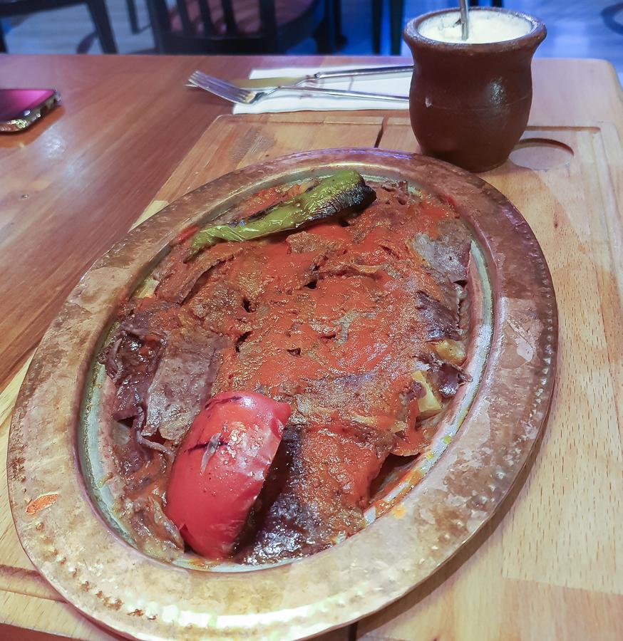Iskender doner dish. It is Doner kebab in frying-pan with bread, yogurt and tomato sauce. I tried this in Taksim Kebap restaurant in Baku, Azerbaijan.