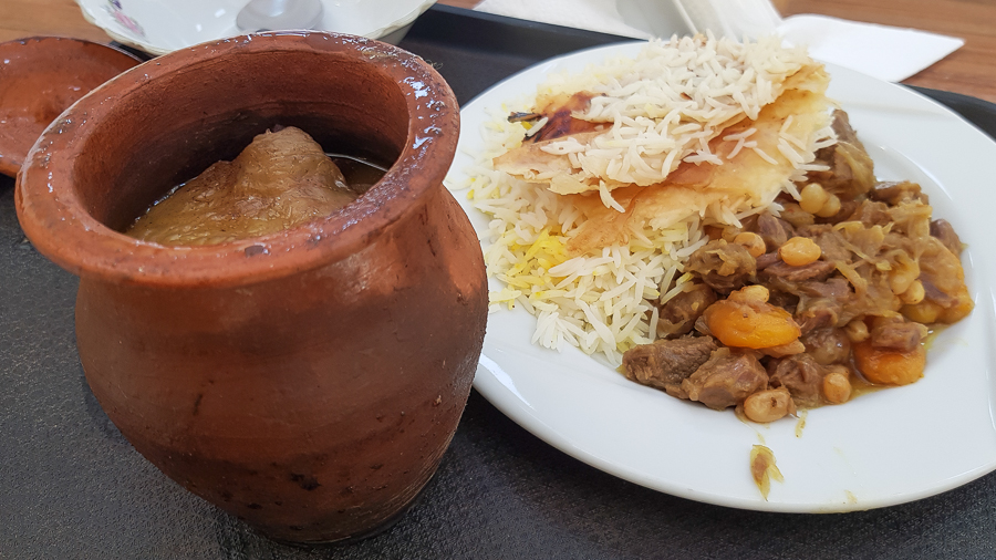 And here is another Azerbaijani dish I like very much: Shaki Piti. It's a mutton stew, but the Azerbaijani version (or at least the one I tried) has chesnuts and chickpeas and it is slow cooked for hours in individual clay pots. Next to it you can see meat with onions, white raisins, and apricot served with rice and bread crust.