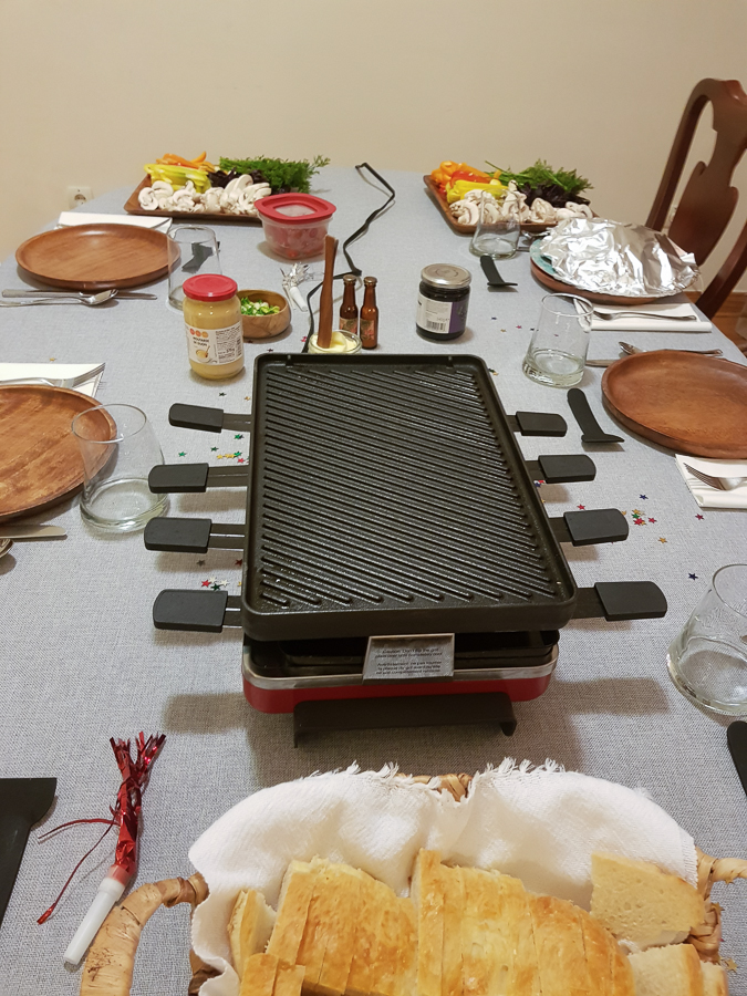 My last meal of 2018 was this Swiss raclette. Raclette is a type of cheese, as well as the dish. The dish is heated raclette cheese scrapped onto a sort of ingredients on your plate. These ingredients may be potatoes, other vegetables, and ham, salami and the like.
