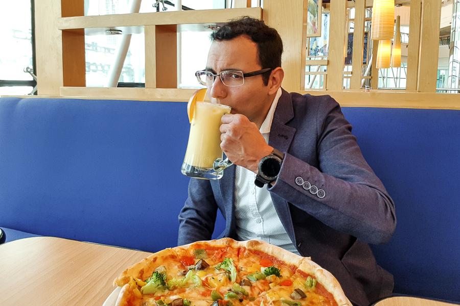 Vegetarian pizza and piña colada in Doha, Qatar.